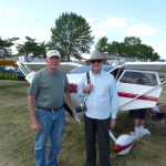Jim Clement in front of his 2009 lindy award winning 0-360 powered Tailwind as aviation writer Jack Cox looks on.